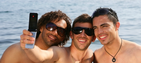 3 men on a beach